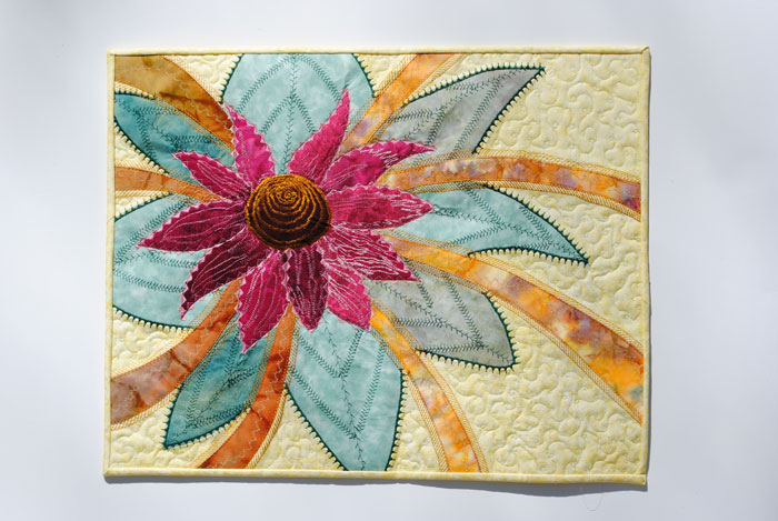 Applique art quilt of flower