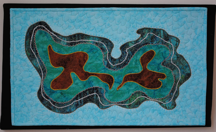 Abstract art quilt in blues and greens