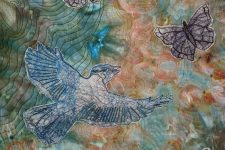 Close up of bird stitched in Angelina fiber